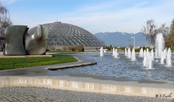 Knife Edge - Two Piece, the fountain and the Bloedel Conservatory with the North Shore mountains in the background. Photo © Vicky Earle